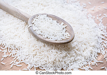 A Wooden Kitchen Spoon On A Pile Of Rice