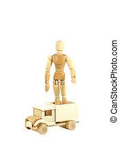 Wooden manikin standing on truck