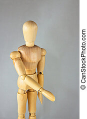 A wooden mannequin give a hand, greets. isolated