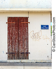 A wooden old door and plate and plate with name of the street, Avenue du General de Gaulle