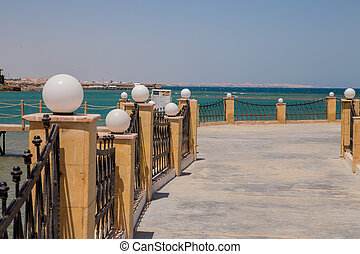 wooden pier to the clear sea