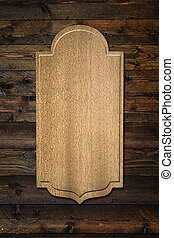 a wooden plaque on the wall