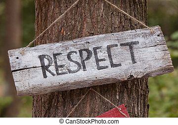 A wooden plaque with the word respect