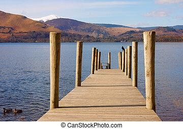 A wooden pontoon on a lake