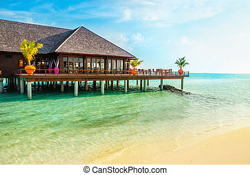 A wooden restaurant on the water, Maldives
