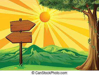 A wooden signboard with a view of the sunset
