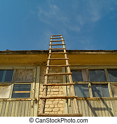 wooden staircase leaning against the building