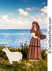 A wooden statue, part of a nativity scene on the sea in southern Italy