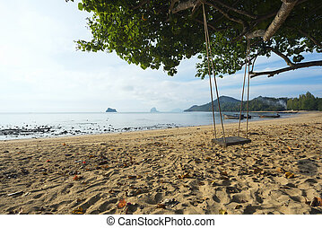A wooden swing on the beach of Thailand
