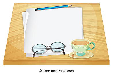 A wooden table with an empty paper and a cup of tea