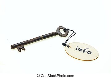 "A wooden tag with ""info"" text on old rusty key, isolated on white background"