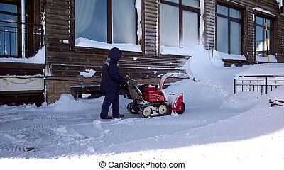A worker cleans the snow with a Rosa Khutor snowplow 01/24/2019