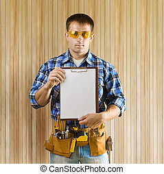 a worker holds clipboard