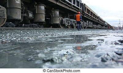 A worker inspects railroad train