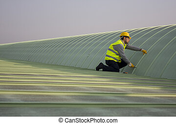 roof - A worker is controlling the roof