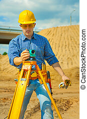 a worker with theodolite