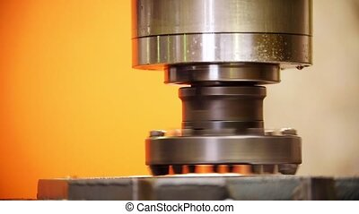 A working industrial cutting lathe. The cutting part turning around itself