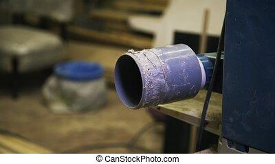 A Working industrial machine. Wood processing. Flying sawdust.