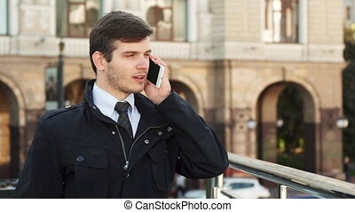 A working man has a serious telephone conversation