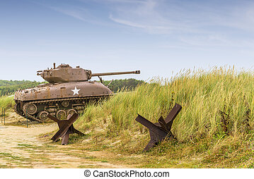 sherman tank - a ww2 sherman tank on utah beach normandy.