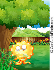 A yellow monster under the tree in the gated yard - ...