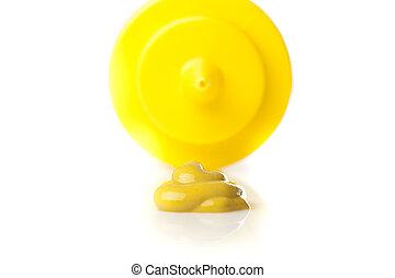 A yellow mustard bottle