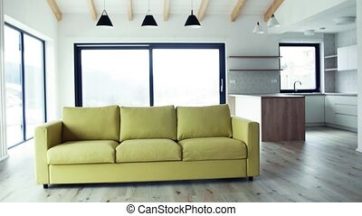 A yellow sofa in modern interior of a house or flat in new...