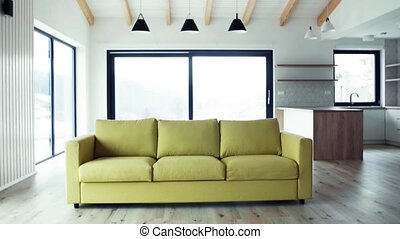A yellow sofa in modern interior of a house or flat in new ...