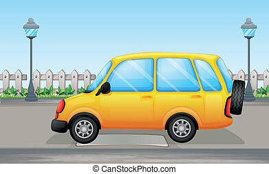 A yellow van in the street