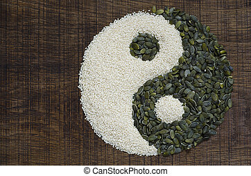 A yin yang made from seeds - The yin yang created out of...