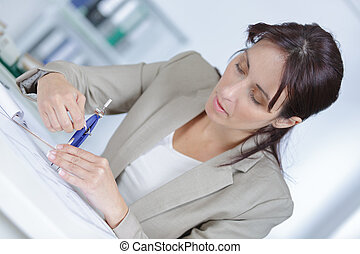 a young adult woman developing a architectural plan at home