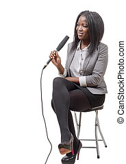 young African american journalist with a microphone