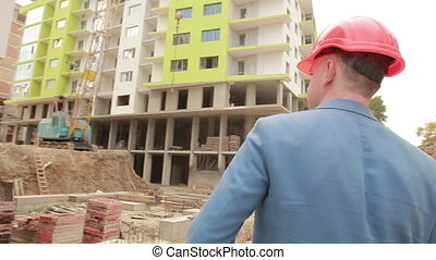 young architect goes to the construction site