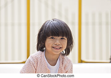 A young asian girl smiling