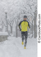 A young athlete with a beard during a run in the snow