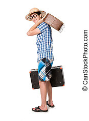 A young, attractive gay guy with glasses and two suitcases ready