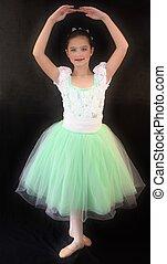 A Young Ballerina in Ballet Pose