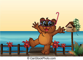 A young bear at the wooden bridge