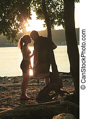 A Young beautiful couple at the sunset