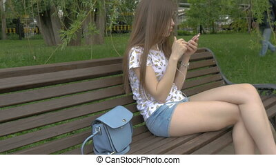 A young beautiful girl does not know that her wallet was...