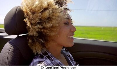 A Young Black Woman Driving A Cabriolet In Summer