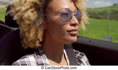 A Young Black Woman Driving - Co-driver view of young...