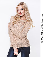 blond  woman in  jeans and a beige sweater