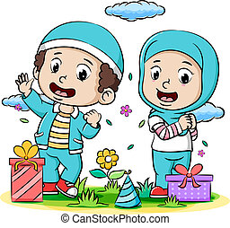A young Boy and a young girl Muslim celebrating ied fitr