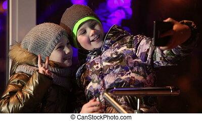 A young boy and girl selfi