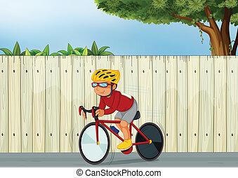 A young boy biking