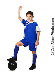 A young boy football player in blue uniform