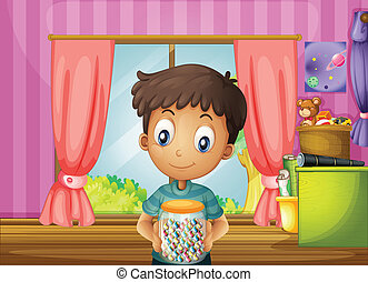 A young boy holding a jar of candies