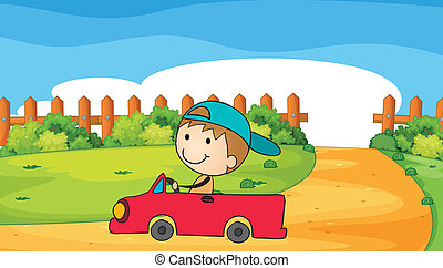 A young boy in his car