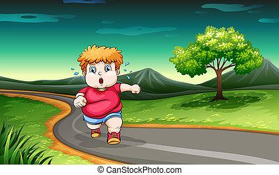 A young boy jogging